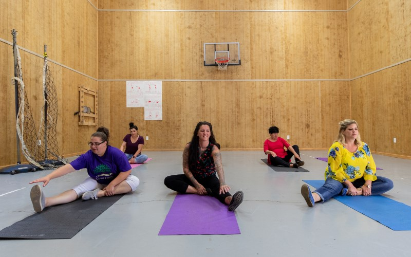 Patients participate in a yoga class in a fitness area at Cove Forge.
